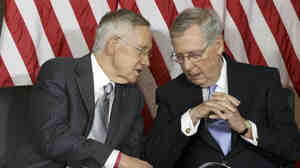 Senate Majority Leader Harry Reid of Nevada (left) talks with Senate Minority Leader Mitch McConnell of Kentucky. The two Senate leaders were on opposite sides of a proposed constitutional amendment to limit fundraising and spending in campaign politics.