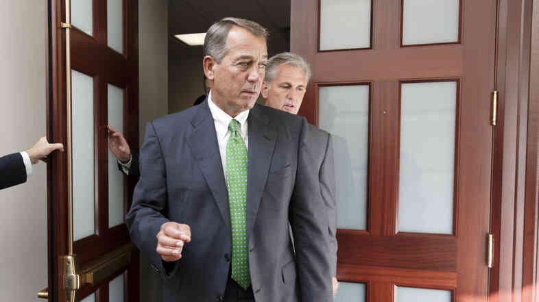 House Speaker John Boehner, R-Ohio, on Capitol Hill on Thursday. Boehner says Congress stands ready to work with the president on the threat from Islamic State militants.