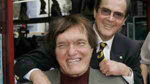 Richard Kiel (front) and Roger Moore at a ceremony in 2007 to honor Moore with a star on the Hollywood Walk of Fame. Kiel, who played Jaws in two Bond films opposite Moore, died Wednesday. He was 74.