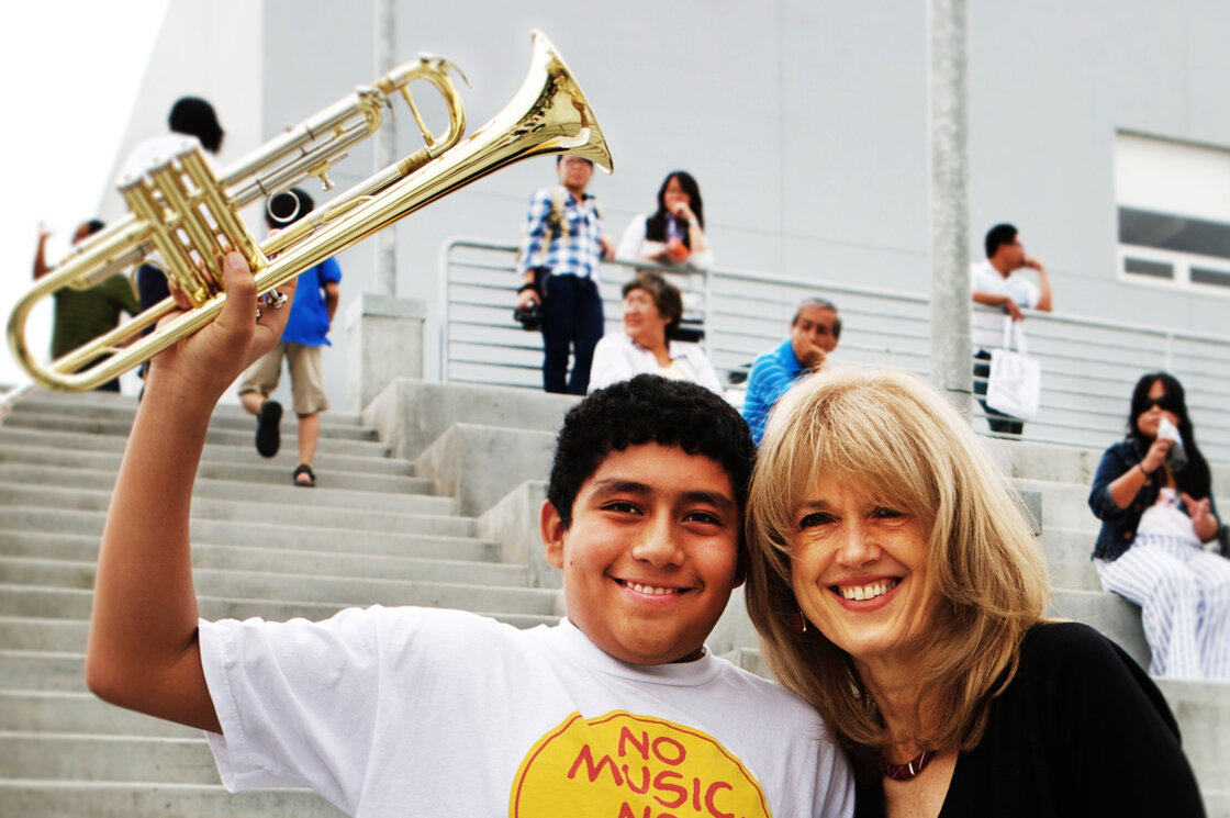 Margaret Martin (right) poses with student Jose Correa during a Harmony Project open house at the Ramon C. Cortines School for Visual and Performing Arts in Los Angeles.