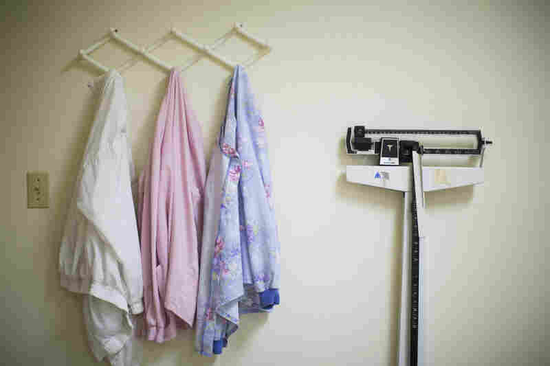 Jackets, once worn by staff members in the lab, hang unused.