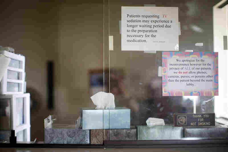 Boxes of tissue are stacked in what used to be the clinic's reception window.