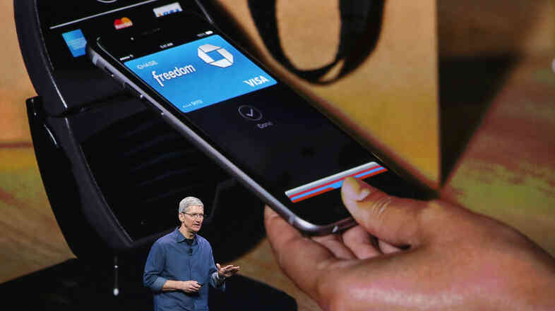 Apple CEO Tim Cook speaks in Cupertino, Calif., on Tuesday. The company unveiled a new mobile payment system called Apple Pay, which uses security built into the latest iPhones.