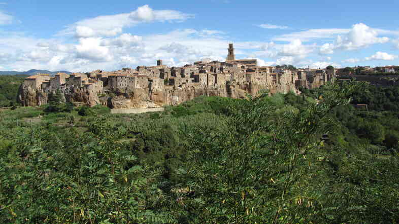 The medieval town of Pitigliano is perched atop a massive volcanic rock, looking out over vineyards and olive groves. It was once home to a vibrant Jewish community, treated with civility or cruelty depending on who was in charge of the city; now, the town works to preserve and share the cultural history of Italian Jews.