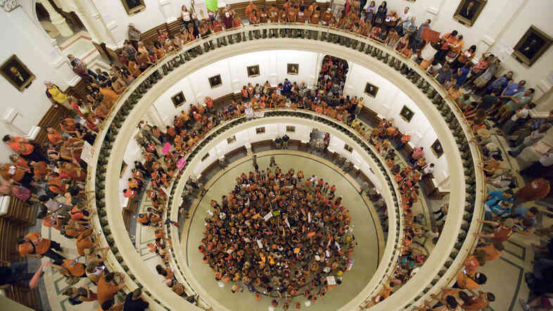 Abortion-rights advocates filled the rotunda of the state capitol in July 2013 as Texas senators debated sweeping abortion restrictions. Some of those restrictions are now under federal review.