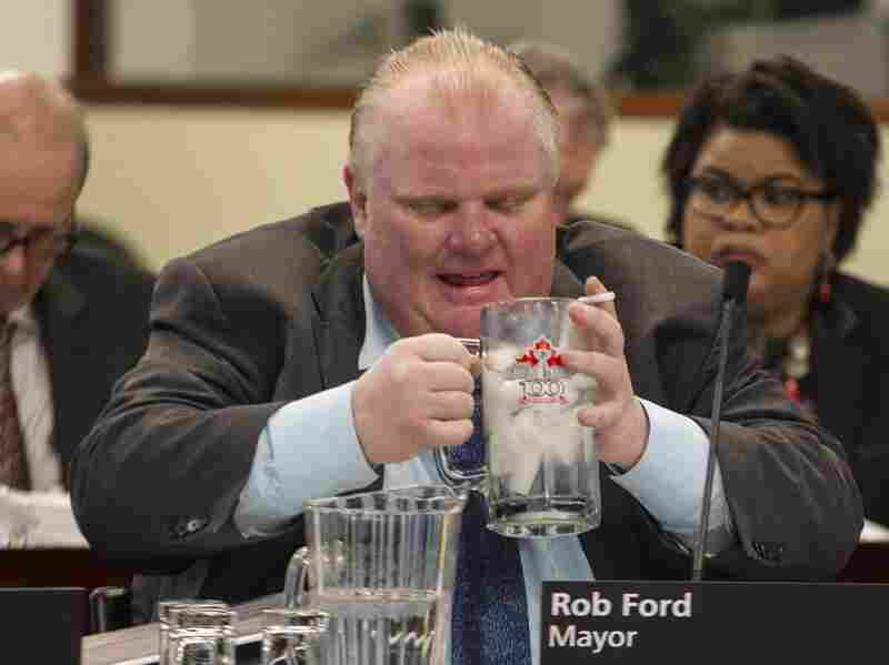 Toronto Mayor Rob Ford, seen here in December 2013, announced Friday that he was withdrawing his re-election bid to seek treatment for an abdominal tumor.