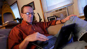 Kevin Evans relaxes in his small apartment after arriving home from work. Evans, who lost income and his home in the recession, is now having his wages garnished after falling behind on his credit card payments.