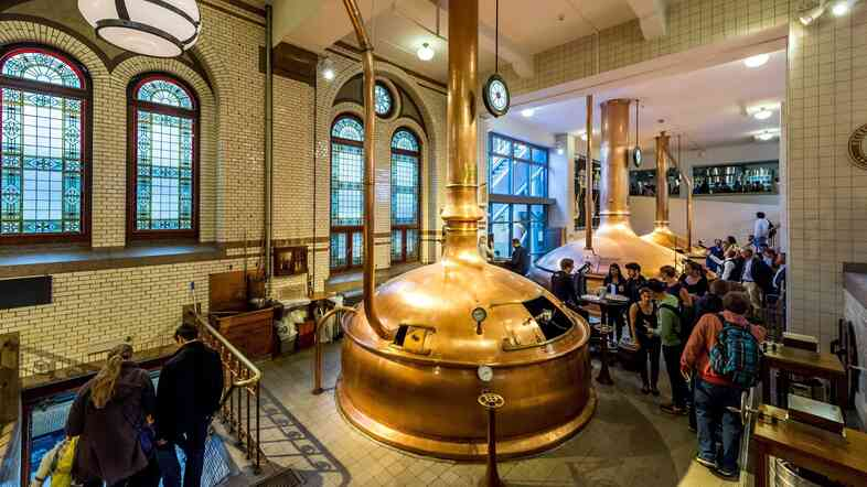 Visitors look at old boil tanks at the Heineken Experience in Amsterdam last month. As it celebrates 150 years of brewing, Heineken has also reportedly rejected a takeover offer from SABMiller.