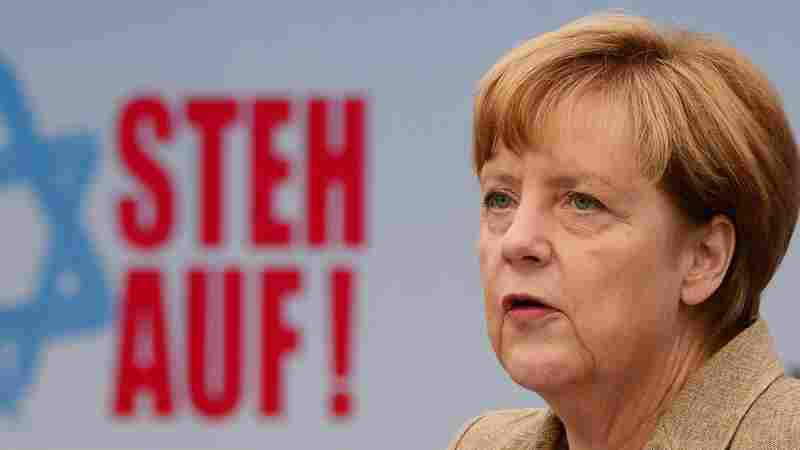 "German Chancellor Angela Merkel addresses a rally against anti-Semitism titled ""Stand Up! Jew Hatred - Never Again!"" in Berlin."