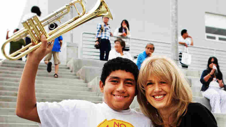 Margaret Martin, right, poses with student Jose Correa during a Harmony Project open house at the Ramon C. Cortines School for Visual and Performing Arts in Los Angeles.