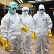 Guinea's Red Cross health workers wearing protective suits in Conakry on September 14.