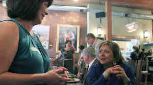 New Mexico Gov. Susana Martinez (right) talks about the state's green chile during a visit to a restaurant in Bernalillo.