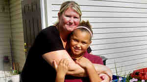 Cara Russo of Gettysburg, Pa., here with 9-year-old Shayla, one of her two daughters, has found success in a program geared to help struggling families navigate past some of the day-to-day obstacles that keep many poor.