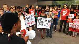 Members of the Ohio Student Association gather outside Ohio Attorney General Mike DeWine's office in Columbus last month to call for the release of in-store video in the fatal police shooting of John Crawford III.