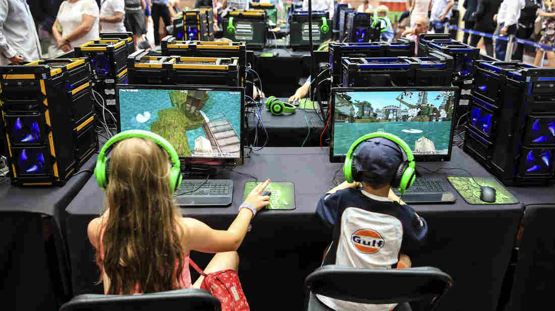 Two youngsters play in a Minecraft tournament Aug. 9 in Ascot, England.