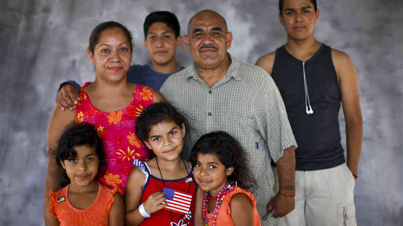Alexander Morales, who served in the Army in the 1970s, with his family: wife Roberta; Elvia, 7, Elena, 8, and Elvira, 7 (in front), and Ruben Verdugo, 13, and Aaron D. Huerta, 17 (in back). Morales' family has been going for years to the Stand Down event in San Diego, where veterans receive assistance.