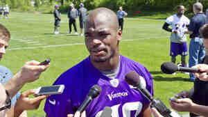 Minnesota Vikings running back Adrian Peterson, seen here at a practice in late May, has been reinstated after he was benched over alleged child abuse.