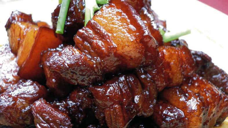 The key to authentic hongshao rou, or red-braised pork, is two use two different types of soy sauce — light and dark.