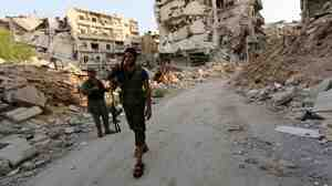Syrian rebel fighters in the northern city of Aleppo in August. The Obama administration has been vetting rebel groups and decided that more than a dozen are moderate enough to arm.