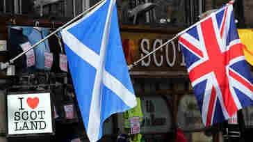 A Scottish flag and a Union flag fly outside a Scottish memorabilia shop in Edinburgh. Scotland votes Thursday on whether it wants independence from the United Kingdom.