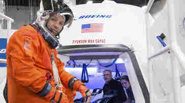 In an image provided by NASA, astronaut Randy Bresnik prepares to enter Boeing's CST-100 spacecraft for an evaluation at the company's Houston Product Support Center. NASA awarded Boeing with a $4.2 billion Tuesday.