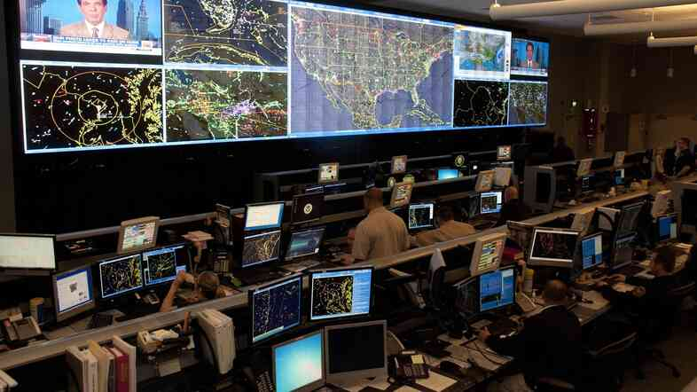 Agents at the Air and Marine Operations Center in at an Air Force Reserve base in Riverside, Calif. track 20,000 to 25,000 flights a day for suspicious activity.