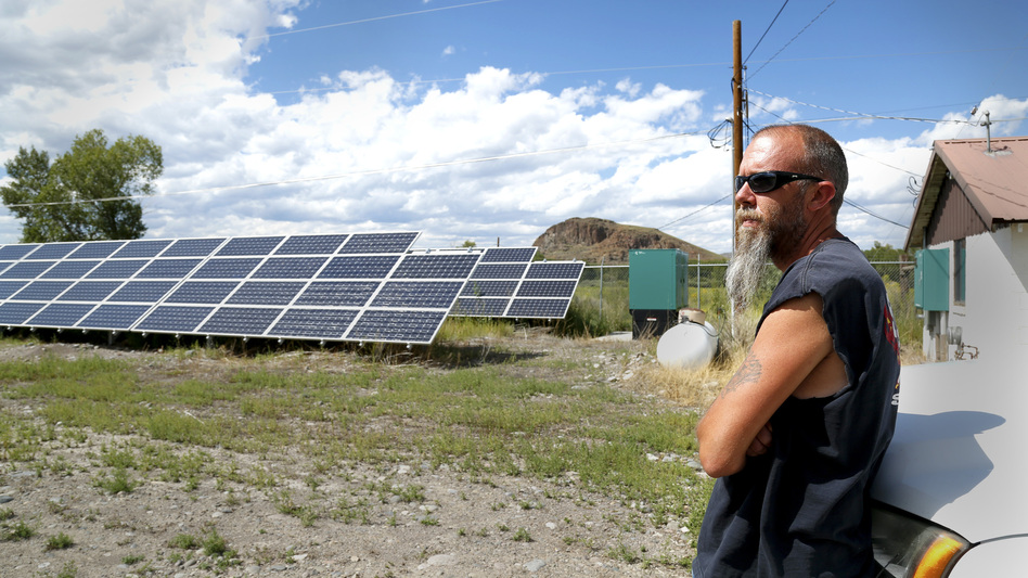 In Del Norte, Colo., Public Works Supervisor Kevin Larimore shows off solar panels that provide electricity for the town's water supply. Despite generating its own solar energy, the town is still at risk of a blackout if its main power line goes down. (Dan Boyce/Inside Energy)