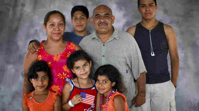 Alexander Morales, who served in the Army in the 1970s, with his wife, Roberta and family: Elvia, 7, Elena, 8, and Elvira, 7 (in front), Ruben Verdugo, 13, and Aaron D. Huerta, 17 (in back). Morales' family has been going for years to the Stand Down event in San Diego, where veterans receive assistance.