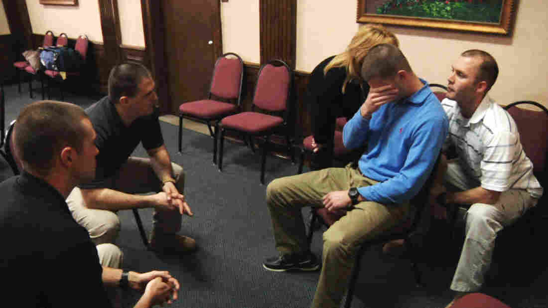 In this image taken from video on Jan. 15, police officers Edward Sarama (from left) and Robert McGuire try to talk to officer Matt Dougherty, who is pretending to be mentally ill, during a training simulation at Montgomery County Emergency Service in Norristown, Pa.