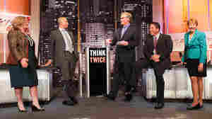 "Education experts faced off on the motion ""Embrace the Common Core"" at an Intelligence Squared U.S. debate, moderated by John Donvan (center)."
