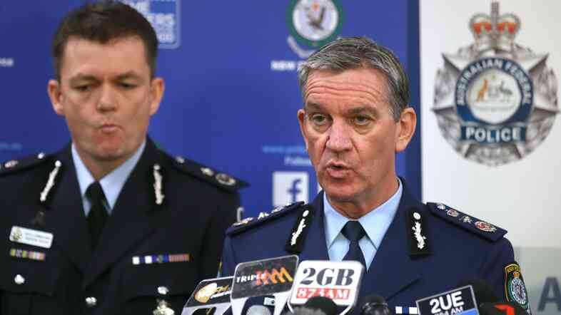 New South Wales Police Commissioner Andrew Scipione (right) and Australian Federal Police Acting Commissioner Andrew Colvin describe how 800 federal and state police officers raided more than two-dozen properties as part of the operation Thursday in Sydney.
