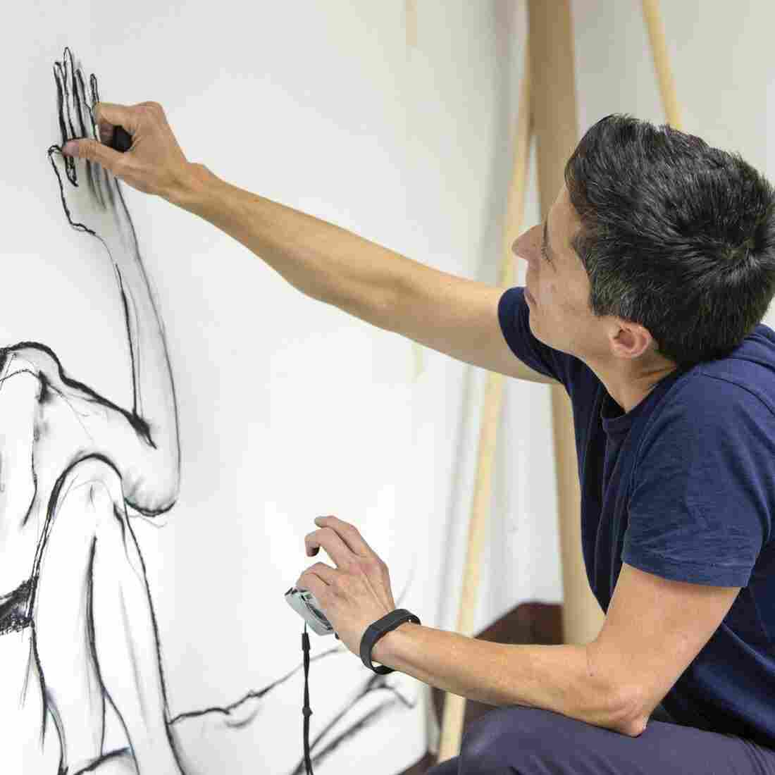 U.S. cartoonist Alison Bechdel works Sept. 2 in her studio at the castle of Civitella Ranieri, central Italy.