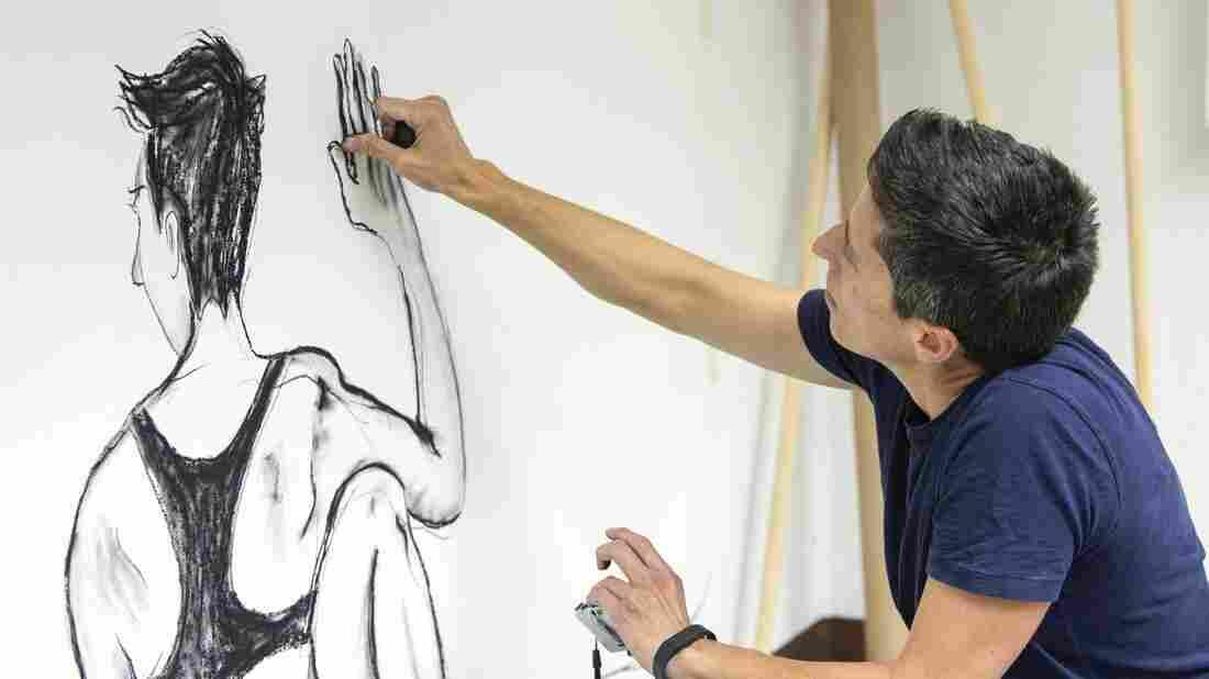 U.S. cartoonist Alison Bechdel works Sept. 2 in her studio at the castle of Civitella Ranieri, central Italy.