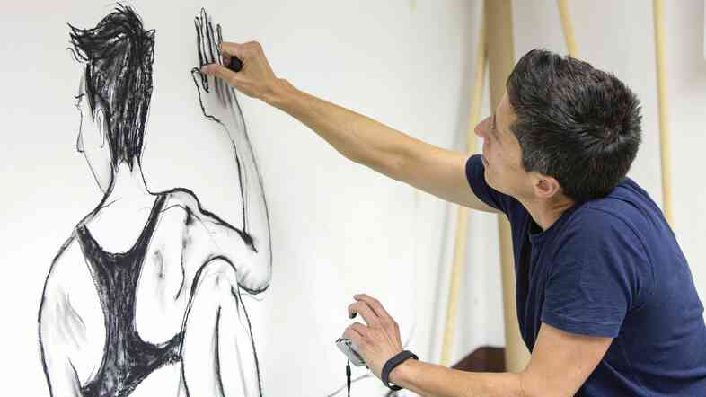 U.S. cartoonist Alison Bechdel works in her studio at the castle of Civitella Ranieri in central Italy on Sept. 2.