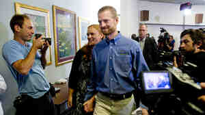 Ebola survivor Dr. Kent Brantly and his wife, Amber, leave a news conference after his release from Emory University Hospital on August 21.