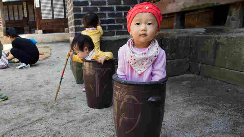 Jung Ha-yoon, 2, and other children in Seoul, South Korea, enjoy playing around (and in) ceramic jars. The country's infant mortality rate dropped 91 percent between 1972 and 2012.