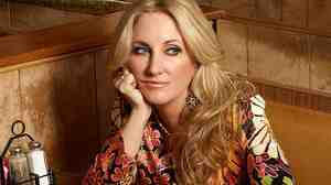 Download a song from Lee Ann Womack's new album, The Way I'm Livin'.