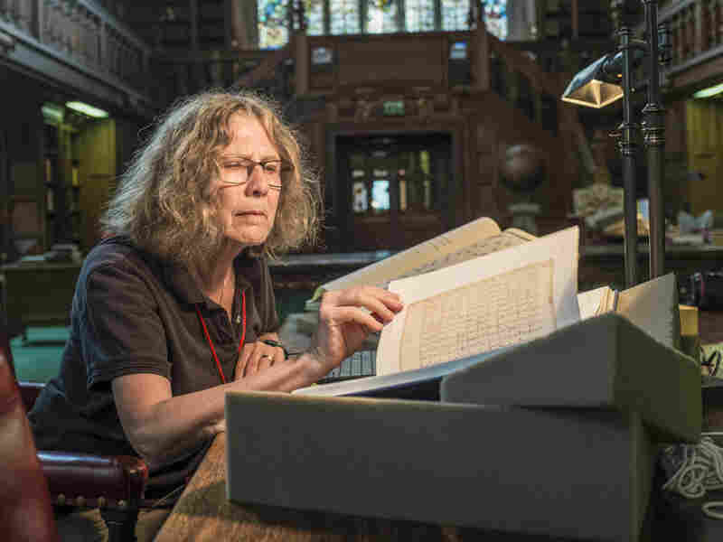 Pamela O. Long examines a book Sept. 5 at the Folger Shakespeare Library in Washington.