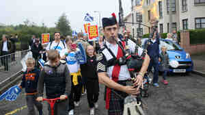 "A man played bagpipes on a ""short walk to freedom"" march in Edinburgh, Scotland, on Thursday as polling in the independence referendum began."