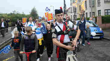 """A man plays the bagpipes on a """"short walk to freedom"""" march in Edinburgh, Scotland on Thursday as polling in the independence referendum began."""