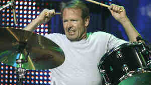 Drummer Simon Kirke is so going to let those cymbals have it in this 2009 performance with Bad Company.
