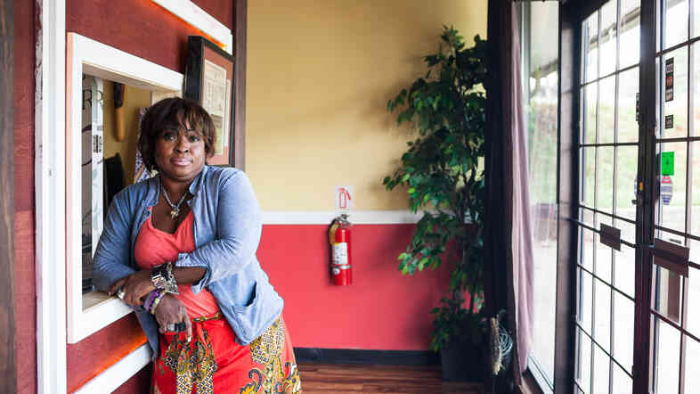 Mina Bestman moved to Georgia from Liberia almost 20 years ago. She owns Mina's Cuisine, a West African restaurant that caters to homesick Liberians.