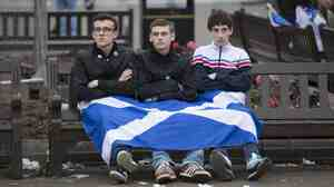 """Dejected """"yes"""" supporters sit in George Square, Glasgow, Scotland, on Friday. Scots voted decisively against independence from the U.K."""