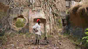 Braima Bangura, a caretaker, stands amid the ruins of Bunce Island's slave castle. Africans destined for slavery in the rice fields of the American South were held here.