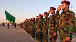 Members of the Mehdi Army militia, which once fought U.S. forces in Iraq, take part in training in the southern Iraqi city of Basra on June 17. The militia's fighters now find themselves allied with the U.S. against the self-declared Islamic State.