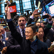 Founder and Executive Chairman of Alibaba Group Jack Ma celebrates as the Alibaba stock goes live on Friday.