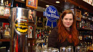 Elizabeth Lessner stands behind the bar at Betty's Food and Spirits in Columbus, Ohio, in 2004.