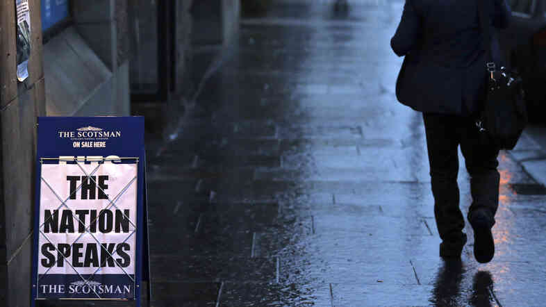 A newspaper advertising board displays a message for the Scottish independence referendum at a news agent on the Royal Mile in Edinburgh, Scotland, on Friday.