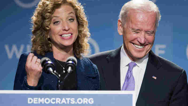 Vice President Biden laughs as he is introduced by DNC Chair Rep. Debbie Wasserman Schultz, D-Fla., at the DNC Women's Leadership conference in Washington, Friday. At the event, Biden praised former GOP Sen. Bob Packwood, who resigned from the Senate in 1995 after allegations of sexual misconduct.