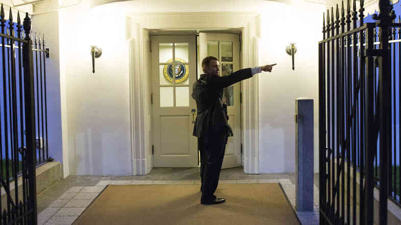 A Secret Service agent gives directions during an evacuation from the White House minutes after President Barack Obama departed for Camp David aboard Marine One on Friday in Washington.